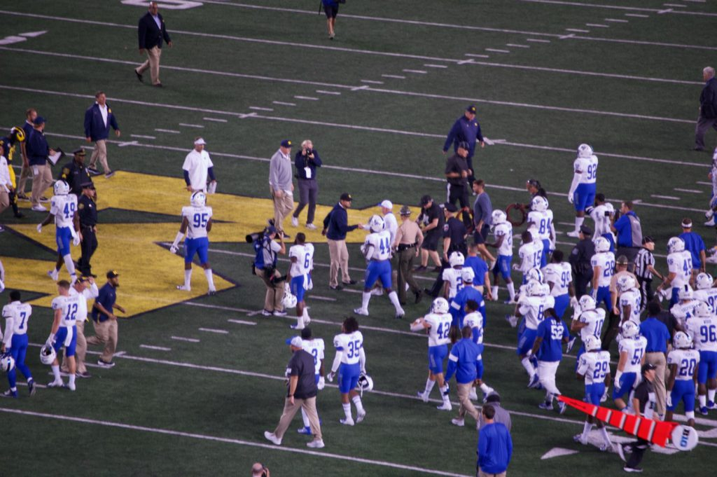 Jim Harbaugh shaking Rick Stockstill's hand post-game