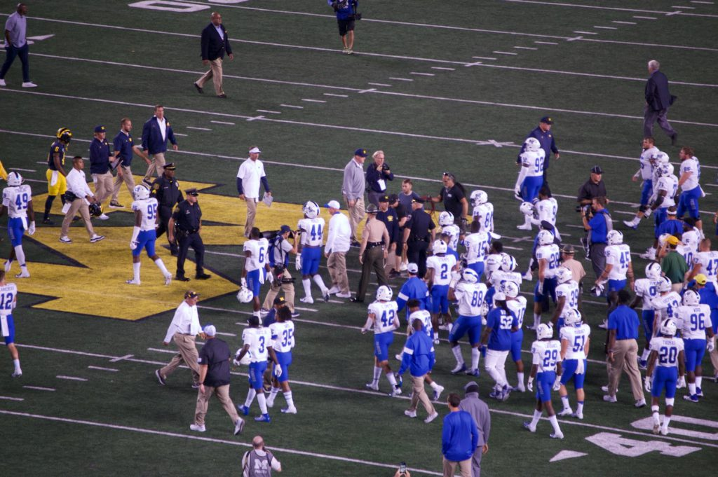 Jim Harbaugh talking to Middle Tennessee players post-game