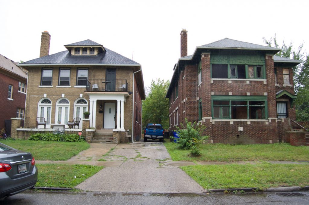 Restored home next to an abandon house in Detroit, Michigan
