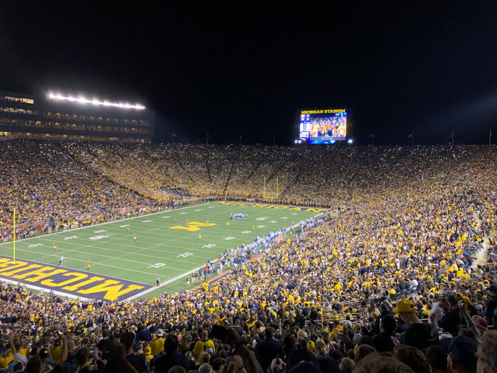 Middle Tennessee Blue Raiders at Michigan Wolverines at night with flashlights